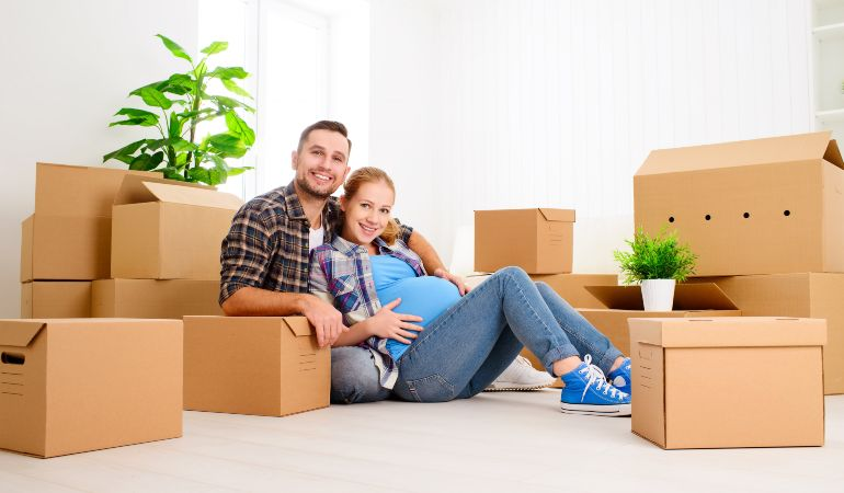 Family preparing to move house while expecting a baby