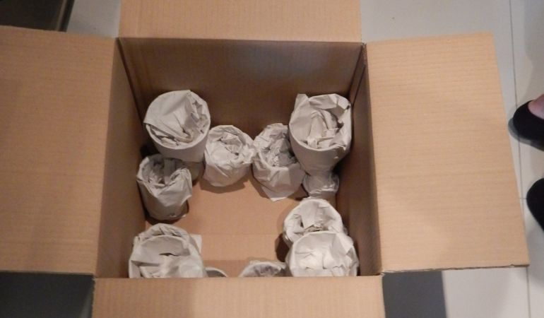 a moving box filled with kitchenware