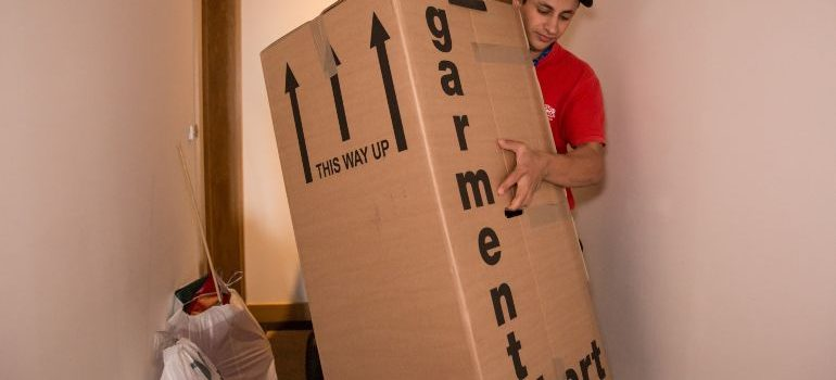 Professional mover handling a heavy moving box