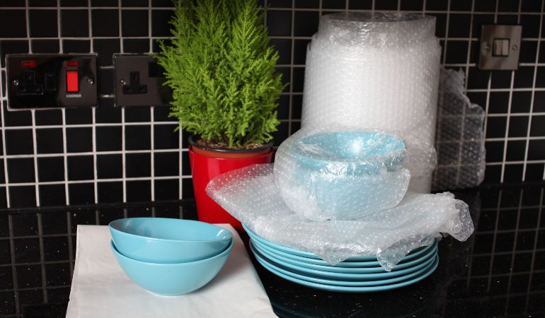 Bowls and plates safely packed with bubble wrap