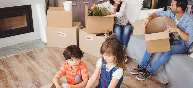 Family with kids packing for a move