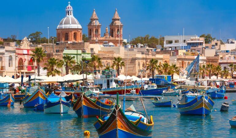 Colorful boats in the Harbor of Mediterranean fishing village Marsaxlokk, Malta