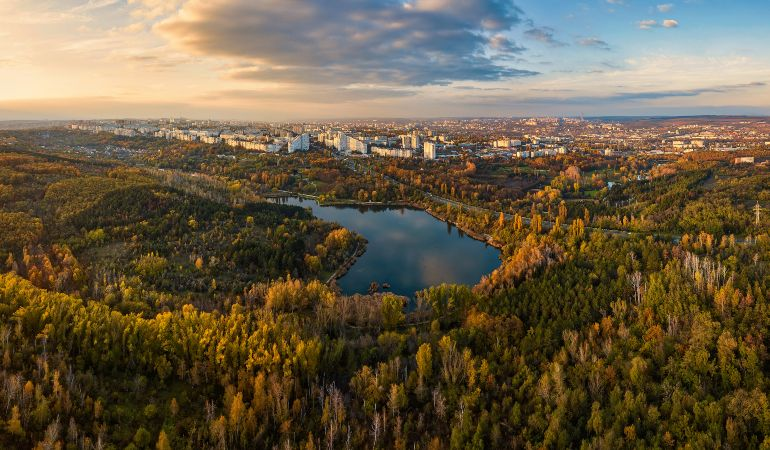Aerial view of a lake in a park with autumn trees in Kishinev, Moldova