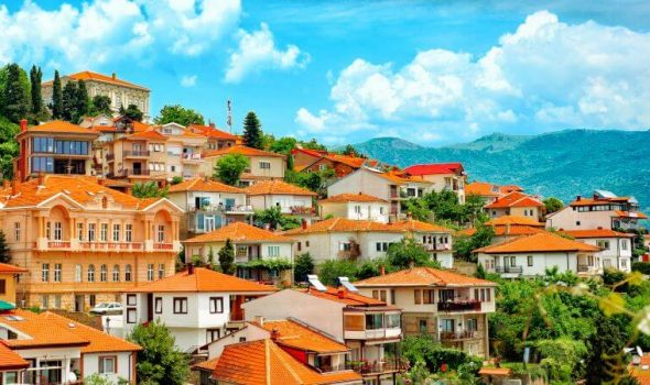 Different buildings and houses with red roofs on hill Ohrid North macedonia.